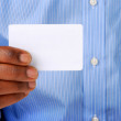 Man holding a blank card - Stock Photo