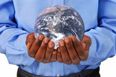 The globe in hands — Stock Photo