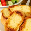 Garlic bread served with Greek salad — Stock Photo #12623892