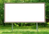 Billboard among greenery — Stock Photo