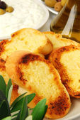 Tzatziki served with garlic bread — Stock Photo