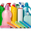 Colorful containers of cleaning supplies and sponges - Stok fotoğraf