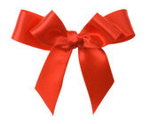 Red ribbon bow on white background — Stok fotoğraf