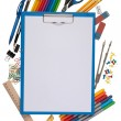 Notepad with stationary objects in the background — Stock Photo