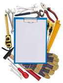 Notepad with tools in the background — Stock Photo
