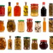 Jars and bottles with pickles, sauces and olive oil — Stock Photo #14013721