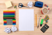 Desk with sheet of paper and stationery objects — Foto Stock