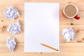 Sheet of paper on a desk — Stock Photo