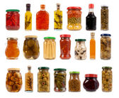 Jars and bottles with pickles, sauces and olive oil — Stock Photo
