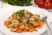 Ravioli in tomato sauce — Stock Photo