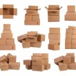 Stacks of cardboard boxes isolated on white background — Foto Stock #22869726