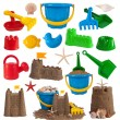 Beach toys and sand castles isolated on white background - Stock Photo