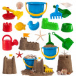 Beach toys and sand castles isolated on white background — Stock Photo