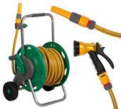 Gardening hose with nozzles isolated on white background — Stock Photo