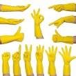 Hand gestures in yellow rubber glove — Stock Photo #22923902