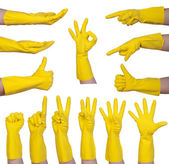 Hand gestures in yellow rubber glove — Stock Photo