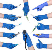 Hand in protective glove holding medical objects — Stock Photo