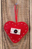 Heart decoration hanging against wooden background — Stok fotoğraf