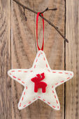 Star decoration hanging against wooden background — Stockfoto