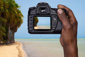 Man taking a picture of a beach — Stock Photo