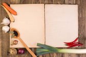 Cookery book on wooden background — Stockfoto
