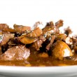 Veal with mushroom sauce - Stock Photo