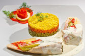 Chicken breast with sliced vegetables and three coloured rice — Stock Photo