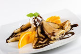 Pancakes with chocolate and orange — Stock Photo