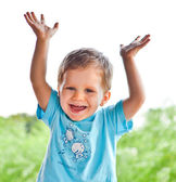 Two year old happy boy rising hands — Stock Photo
