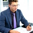 Young business man working in the office — Stock Photo