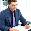 Young business man working in the office — Stock Photo #13365831