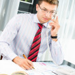 Successfull young business man speaking on the phone — Stock Photo #13365843