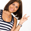 Portrait of young woman showing victory sign — Stock Photo