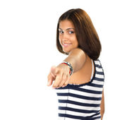 Portrait of young woman pointing with one finger — Stock Photo