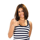 Portrait of young woman with thumbs up — Stock Photo