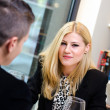 Business woman talking to a business man during lunch — Stock Photo