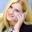 Young business woman talking on the phone — Stock Photo