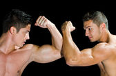 Muscular men showing their muscles — Stock Photo