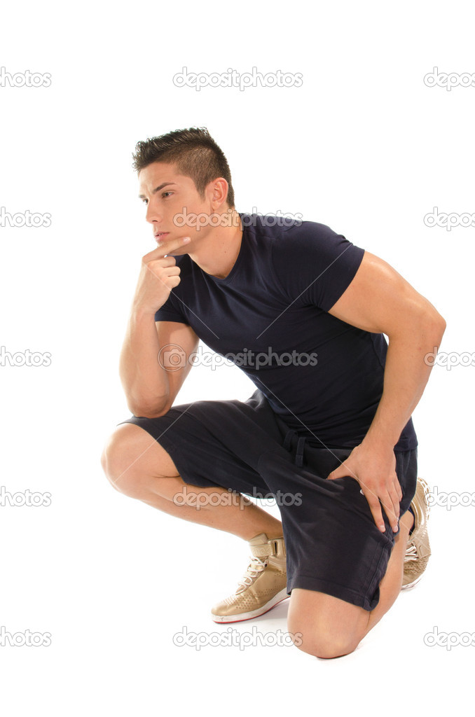 Muscular man with hand on knee thinking with thinker posture — Stock Photo #15552353