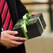 Man hands presenting a gift box — Stock Photo #16217291