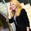 Young businesswoman talking on the phone - Stock Photo