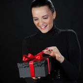 Happy beautiful woman opening a gift box — Stock Photo