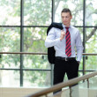 Young businessman standing — Stock Photo