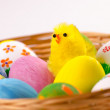 Colorful Easter eggs in a basket — Stock Photo #23723075