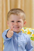 Beautiful child showing ok sign — Stock Photo