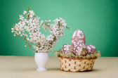 Easter eggs and plum cherry flowers — Stock Photo