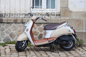 Vespa motorcycle parked in the street — Stock Photo