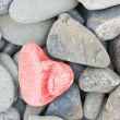 Heart shaped stone painted red — Stock Photo