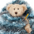 Teddy bear with flu sick thermometer wrapped in a blue blanket — Stock Photo #13600797