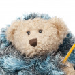 Teddy bear with flu sick thermometer wrapped in a blue blanket — Stock Photo